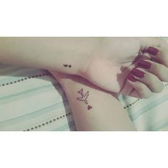 Pin for Later: 40 Tiny Tattoos For Travel-Lovers Heart and Plane