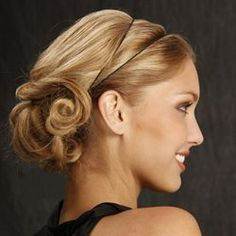 Updo with Alterna-tive Styling Band. Want this do, call Barberella Salon 215-643-4066.