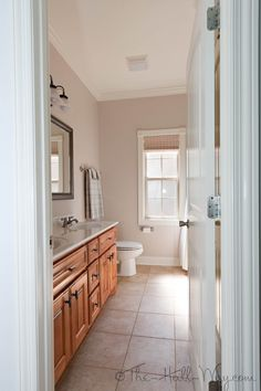 Hall Bathroom - Double Sinks, Bali Woven Wood Blinds, Wall color - SW Reticence