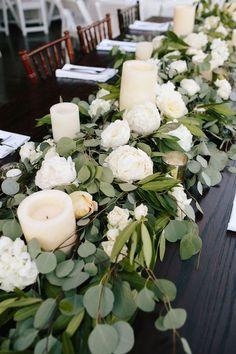 green and white winter wedding centerpiece