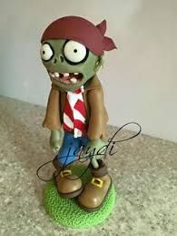 Resultado de imagen para souvenirs de plantas vs zombies Diy Clay, Clay Crafts, Zombies Vs, Polymer Clay Disney, Zombie Party, Pasta Flexible, Cold Porcelain, Art Dolls, Cake Toppers