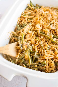 Slow Cooker Fresh Green Bean Casserole with crispy onions in a white casserole dish.