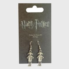 Two earrings featuring Dobby the House Elf.