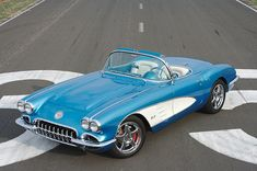 '59 Corvette.  Lets make it purple with chocolate interior.  Yes.  I customized it.