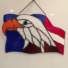 "10"" X 16"" stained glass panel of our American Eagle and Flag. Now more than ever we need to show our countries colors. The glass features have been personally chosen to represent the texture of the Wh"