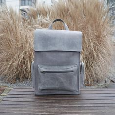 Handmade Gray leather backpack made from cowhide leather of vintage style  - One roomy compartment ( fits Laptop 15) - one slip pocket inside (18cm * 15cm) - strap width 2,7 cm - main compartment closes on snap buttons - one front zipper pocket 25 * 17 * 3cm (9,8 * 6,7 * 1,2 in) - two zipper pockets on sides 8 * 17 * 3 cm ( 3,15* 6,7 * 1,2 in) Available to order in black, gray, red, brown, dark blue, orange and green colors.  DIMENSIONS:  Height: 40 cm / 15,7 in Width: 30 cm / 11,8...