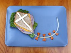 What You'll Need:  1 sandwich (your choice)  1 celery stalk  2–3 baby carrots  string cheese    To Make Kite Sandwich:  Cut a kite shape out of the bread and make any sandwich you would like. Cut the string cheese in half lengthwise, then cut strips to fit kite dimensions. Peel a strip of celery for the kite tail. Cut baby carrots into triangle pieces and put in place for the tail bows.