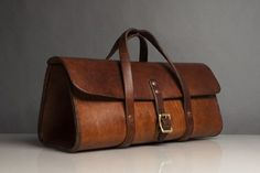 Brown leather toolbag.
