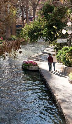 Simple pleasures walking hand & hand on San Antonio River Walk in San Antonio, Texas •
