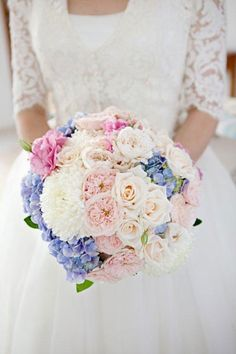 Informal posy of David Austin roses, hydrangea, lisianthus and roses - Image by Chesterton Smith Photography