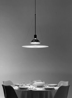 The real design. Function, elegance, industrial genius. FRISBI for FLOS by Achille Castiglioni