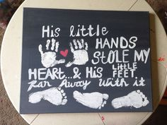 My sons handprints and footprints on a canvas.