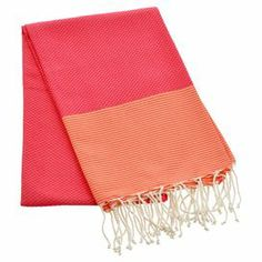 "Add a spa-worthy touch to your master bath with this hand-woven cotton fouta towel, featuring fringed ends and a color-blocked motif.   Product: Fouta towelConstruction Material: CottonColor: Fuchsia and orangeFeatures:  Made on weaving loomAbsorbent and fast dryingHand-woven Oversized designDimensions: 78"" x 39""Cleaning and Care: Wash twice in cold water and tumble dry on low before use. The result is a softer more absorbent fouta."