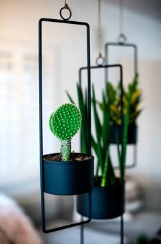 20 stylish hanging planters for small space dwellers 20 stylish hanging planters for small space dwellers - Black metal planters Metal Hanging Planters, Copper Planters, Hanging Air Plants, Decorative Planters, Modern Planters, White Planters, Diy Planters, Diy Hanging, Plants Indoor
