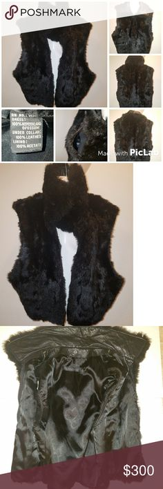 """Vintage 100% New Zealand Possum fur vest Authentic Vintage Andrew Marc 100% New Zealand Opossum fur vest with 100%leather under collar. Medium. Zip front. Beautiful vest in great condition. 24"""" long with the collar down. 12"""" Longline arm holes. Minor scratches on leather collar shown in final photos in different lighting.  Will consider offers. Andrew Marc Jackets & Coats Vests"""