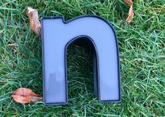 Reclaimed metal letter  n by RumRiverOriginals on Etsy, $30.00 I like the color inside the letter.