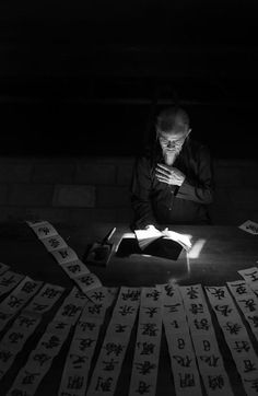 the calligraphy man reading book Photo by Huynh Jet -- National Geographic Your Shot