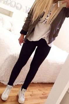Comfy Cute fall winter outfit idea with black leggings white sneakers and a green bomber jacket, perfect everyday look and out for school for teen girls.
