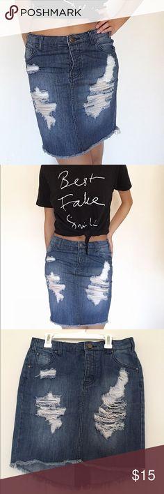 LSV Distressed denim skirt Size 2. LSV distressed denim skirt, mid length curve hugger with stretch denim. Back and front pockets. Worn once LSV Skirts Mini
