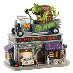 Lemax decorative villages are a holiday tradition made with old-world craftsmanship, combined with new-age technology. Halloween Village, Halloween Decorations, Custom Garages, Light Building, Holiday Traditions, Hot Rods, Old World, Creatures, Christmas Shopping Online