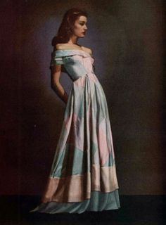 Dress in tartan surah by Jacques Heim; wide bias of two shades of organdy at skirt. Photo by Arik Nepo, 1946