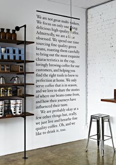 Black text on white wall, naked bulb and great display = ♥