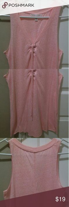 VS Lace Up V Neck Sleeveless Shirt Sz S VS Lace Up V Neck Sleeveless Shirt. Light Coral Color. Runs a little big. Lightweight Material.  Awesome shirt. Excellent condition. Only been worn 1 time as it does not fit me. Victoria's Secret Tops Tank Tops