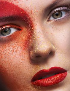 red lips and eyes with gold dusting
