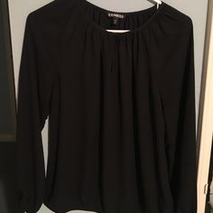 Express top - long sleeve sheer black Flowy long sleeve blouse. Can be casual or formal. Super cute, light weight, and easy to pair with anything. Is XS but runs a bit big. Also have one in burgundy. Both brand new! Great condition. Can do two for a lower price if interested :) Express Tops Blouses