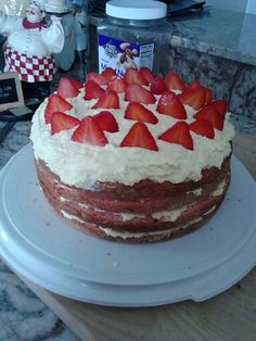 Spring cake...strawberry cake, whipped pudding frosting, and fresh fruit. Yum!