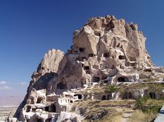 Cappadocia Uchisar Castle, 2000BC, Turkey    The natural rock formation that is Uchisar Castle overlooks the cone shaped rock formations called fairy chimneys at the highest point above Cappadocia.