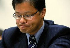WASHINGTON - NOVEMBER 06:  Yahoo! Inc. CEO Jerry Yang pauses during a hearing before the House Foreign Affairs Committee November 6, 2007 on Capitol Hill in Washington, DC. According to reports January 17, 2012, Yang has resigned from Yahoo! Inc's Board of Directors and all other positions they he held at the Internet company.  (Photo by Alex Wong/Getty Images)