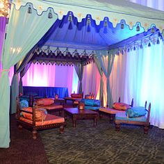 """Indian Wedding in Hawaii- using Raj Tents.  This is the basic idea (sans the spindles) for the """"mighty morphing Persian bed"""" that breaks up into individual divans during the day, then can be reassembled into a king bed at night."""