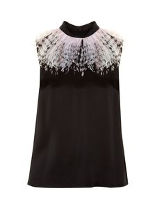 It's the tonal-pink and blue feathered trim that lends Christopher Kane's black cady top a directional feel. It has an unfussy, sleeveless shape with a high neck, and fastens with a button at the back. Style it as the designer would: with similarly accented separates.