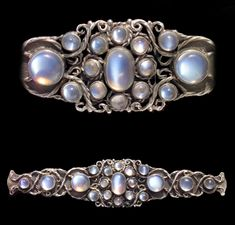 Mary Thew (attrib.). Arts and Crafts brooch. Silver and moonstone, c. 1925. H: 2.4 cm (0.94 in) W: 11.1 cm (4.37 in). Fitted case. Sold by Tadema Gallery.