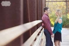 """Sweet pose for an engagement shoot - having the couple stand on a bridge holding hands down low. Loved this """"dressy"""" outfit the couple chose! From a rustic shoot in the fall in Grindstone Park."""