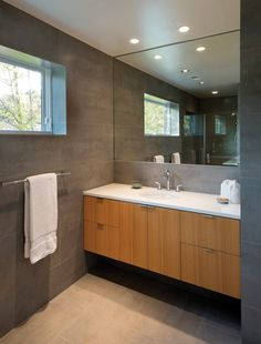 The master bathroom features Porcelanosa tiles and Grohe faucets.