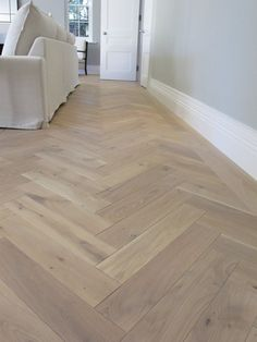 PIN 6 - This a lovely example of how vinyl floorboards can add that wood look to any house with half the cost. Has a great affect paired with the grey walls and white skirting. House Design, New Homes, Kitchen Flooring, House, Home, Living Room Flooring, Basement Flooring, Floor Design, Durable Flooring