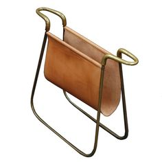 Magazine holder, brass with leather sling. Made by Aubock Studio. Carl Aubock, 1940's. My hands-down favorite accessories are mid-century Carl Aubock. Umbrella stands, coat racks, objects. Such beautiful lines and materials. #magazinerack #CarlAubock