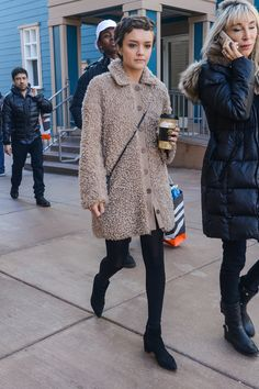 Olivia Cooke is snuggly but cool in a mod-inspired pink teddy coat paired with skinny leggings and pointy-toe boots.   - MarieClaire.com