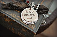 "This necklace inspired from 1 Samuel 16:7 will read, ""The Lord looks at the heart"" stamped on the top copper piece. The bottom aluminum piece which is 1.25 inches will read, ""1 Samuel 16:7."" This will"