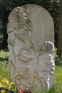 One of the most beautiful stones I have ever seen. In memory of a little English boy named Benjamin. (Note the Teddy he holds in one hand) Horton,Northamptonshire,England Cemetery Monuments, Cemetery Statues, Cemetery Headstones, Old Cemeteries, Cemetery Art, Graveyards, Unusual Headstones, Cemetery Angels, Famous Graves