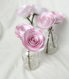 This is a set of three mini mini vases. Each is filled with a 2.5 inch paper rose on a wrapped wire stem. The vase is 4 inches tall, and the total height is about 7 - 8 inches tall. These are perfect
