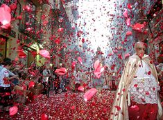 A rain of flower petals fill the streets for the Corpus Christi procession in Valencia, Spain.