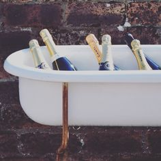 Chill your drinks in this vintage baby bath complete with metal stand