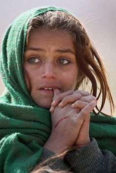 Afghanistan girl This young girl has already had a hard life...fear in her eyes and a nose that looks like it has been broken.