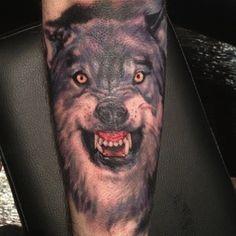 Wolf head tattoo on sex line