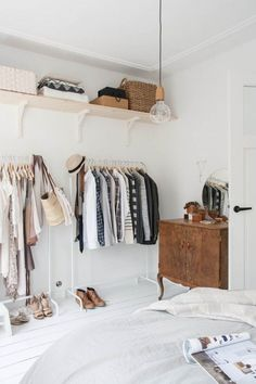 tiny house decorating inspiration - minimalist, modern exposed closet with garment racks and open shelving.