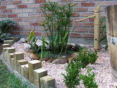 love bamboo n coy ponds together great idea with some river rock!!! <3