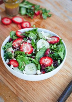 Baby Kale and Strawberry Summer Salad // bably kale, strawberries, dried cranberries, cucumbers, feta and sunflower seeds